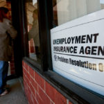 A JOB-SEEKER enters Michigan's Unemployment Insurance Agency Problem Resolution Offices in Livonia, Mich. / BLOOMBERG FILE PHOTO/JEFF KOWALSKY
