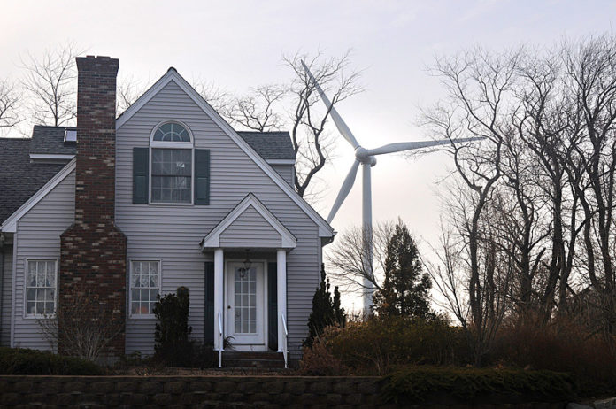 WORTH THE ENERGY? The Portsmouth-owned turbine adjacent to the high school is now broken, with the town recently postponing a decision on whether to spend money to fix it. / PBN FILE PHOTO/FRANK MULLIN