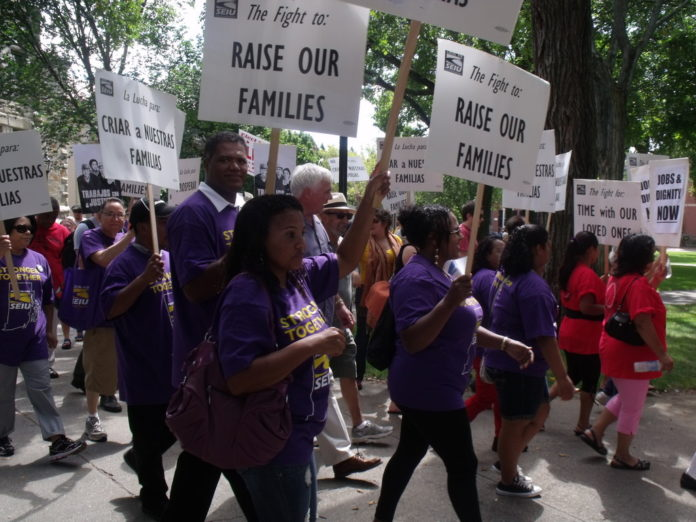 BROWN UNIVERSITY dining service employees were among the marchers in a Labor Day rally put on by the Service Employees International Union Local 615 that started at the school's College Hill campus and proceeded down to the city's Financial District. / COURTESY SEIU LOCAL 615