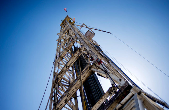 A CHESAPEAKE ENERGY CORP. natural gas rig stands in the North Texas Barnett Shale bed rock deposit near Burleson, Texas. / BLOOMBERG FILE PHOTO/MATT NAGER
