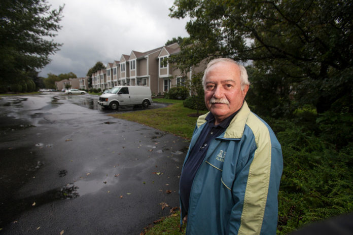OWNER'S RIGHTS: Gene Savory, president of the Bowen Court association, at the condominiums. Twenty years after the Bowen Court condominiums were built, a court decision is giving residents collective ownership of an undeveloped parcel of the property. / PBN PHOTO/DAVID LEVESQUE