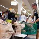 BAG IT: Lucas Flavin bags groceries at Shaw's supermarket in Barrington. The store is phasing out the use of plastic bags. / PBN PHOTO/DAVID LEVESQUE