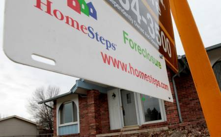 COMPLETED FORECLOSURES plunged by more than 50 percent in the Providence-Fall River-New Bedford area in September.  / BLOOMBERG FILE PHOTO/JEFF KOWALSKY