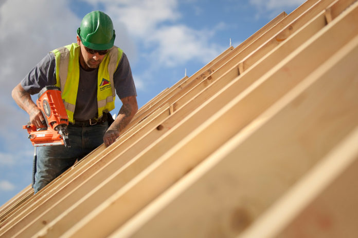 CONSTRUCTION EMPLOYMENT rose 0.5 percent year over year in the Providence-Fall River-Warwick metro area while falling 4 percent in the New Bedford metro area in September.  / BLOOMBERG FILE PHOTO/SIMON DAWSON