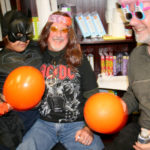 NO TRICK FOR THIS TREAT: AJ Taveras, left, at Big Brothers Big Sisters of the Ocean State's Halloween party with his mentor, James Conway, of Warwick, center. At far right is big brother Joseph Yanish of Cranston. / PBN PHOTO/MICHAEL PERSSON