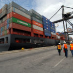 DOCKWORKERS REACHED a tentative agreement with their employers, averting a strike that would have shut down eastern U.S. seaports for the first time in 35 years. / BLOOMBERG FILE PHOTO/RICHARD SHEINWALD