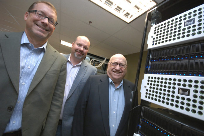 FROM THE LEFT, Richard Petrocelli (founder and director), Robert Petrocelli, (founder and chief technology officer) and Americo Petrocelli (director) of GreenBytes Inc. GreenBytes has announced the relocation of its corporate headquarters from Hopkinton to downtown Providence.  / PBN FILE PHOTO/BRIAN MCDONALD