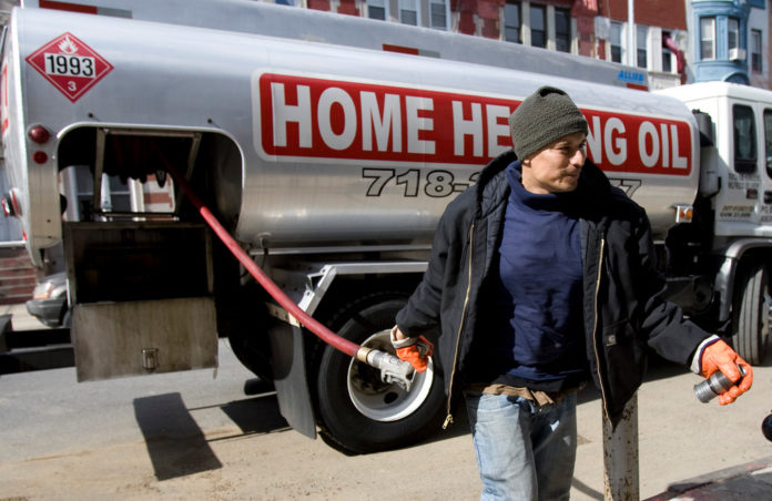 FUNDED BY ENERGY COMPANIES, the Good Neighbor Energy Fund is administered by the United Way to help eligible Rhode Islanders pay their winter heating bills. / BLOOMBERG NEWS FILE PHOTO/ANDREW HARRER