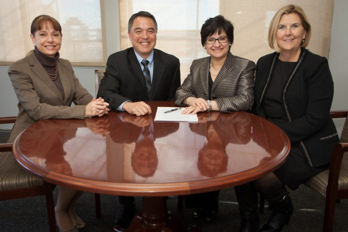 FROM LEFT: Meryl Moss, COO of Coastal Medical; Dr. G. Alan Kurose, president and CEO of Coastal Medical;  Diana Franchitto, president and CEO of Home & Hospice Care of Rhode Island; and Donna M. Gouveia, CPA, president and CEO of Visiting Nurse Home Care, at the signing of the new preferred providers agreement. / COURTESY HOME & HOSPICE CARE OF RHODE ISLAND/SCOTT KINGSLEY