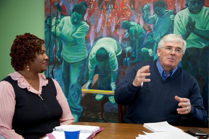 SERVE AND PROTECT: Serve Rhode Island Executive Director Bernie Beaudreau leads a discussion on new nonprofit programs as American Cancer Society Community Executive of Health Initiatives Cheryl Albright looks on. / PBN PHOTO/NATALJA KENT