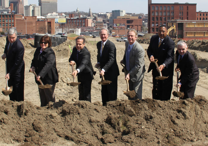 TAKING PART IN A CEREMONIAL GROUNDBREAKING for restoration of the street and utility grid on the former Interstate 195 land in Providence on Monday were, from left, U.S. Sen. Sheldon Whitehouse, R.I. Senate Majority Whip Maryellen Goodwin, U.S. Rep. David N. Cicilline, Gov. Lincoln D. Chafee, Providence Economic Development Director James Bennett, R.I. Department of Transportation Deputy Director Phillip Kydd and U.S. Sen. Jack Reed. / COURTESY JAMES ALVAREZ/OFFICE OF THE GOVERNOR