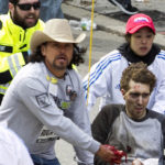 FIRST RESPONDERS including Carlos Arredondo, in cowboy hat, tend to Jeff Bauman, who was severely wounded after two explosions occurred along the final stretch of the Boston Marathon on Boylston Street in Boston on Monday, April 15. / BLOOMBER PHOTO/KELVIN MA
