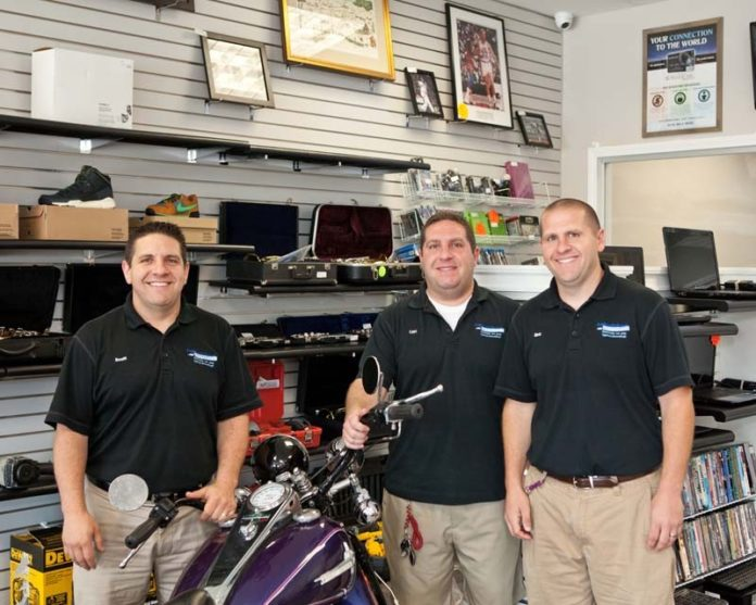 SETTING UP SHOP: From left: Brothers Scott, Cliff and Eric Frye founded Fastcash Pawn & Checkcashers in 2003. Since then, they've looked to grow their business among higher-end clientele. / PBN PHOTO/TRACY JENKINS