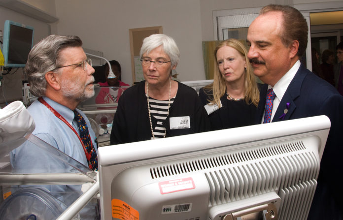 DR. JAMES PADBURY, chief of pediatrics at Women & Infants Hospital, Dr. Jennifer L. Howse, president of the national March of Dimes, Sandra Hijikata, senior vice president and chief revenue office, national March of Dimes, and Larry Merlo, president and CEO of CVS Caremark, touring the Neonatal Intensive Care Unit at Women & Infants Hospital. / PHOTO COURTESY CONSTANCE BROWN
