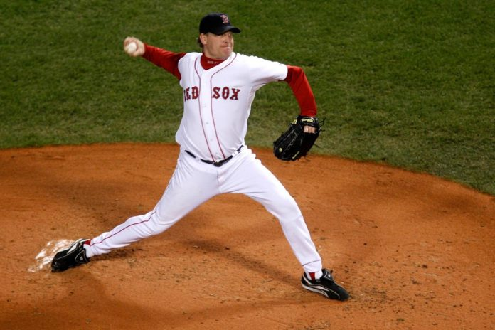 Curt Schilling of the Boston Red Sox pitches against the Colorado Rockies in Game 2 of the Major League Baseball (MLB) World Series at Fenway Park in Boston, Massachusetts, U.S., on Thursday, Oct. 25, 2007. Photographer: Robert Caplin/Bloomberg News / BLOOMBERG NEWS