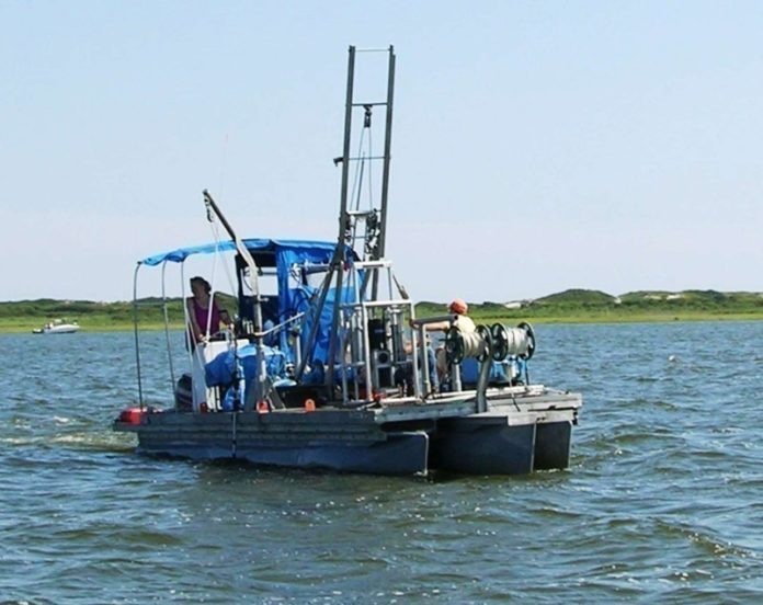 WHAT LIES BENEATH: A coring barge used in a URI Graduate School of Oceanography initiative exploring submerged ancient landscapes. / COURTESY URI