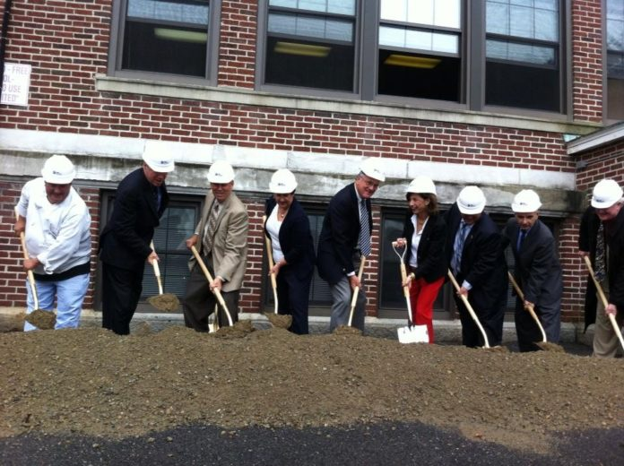 LOCAL OFFICIALS AND MEMBERS of Hope & Main break ground on the nonprofit's new facility, R.I.'s first-ever food business incubator. / COURTESY HOPE & MAIN