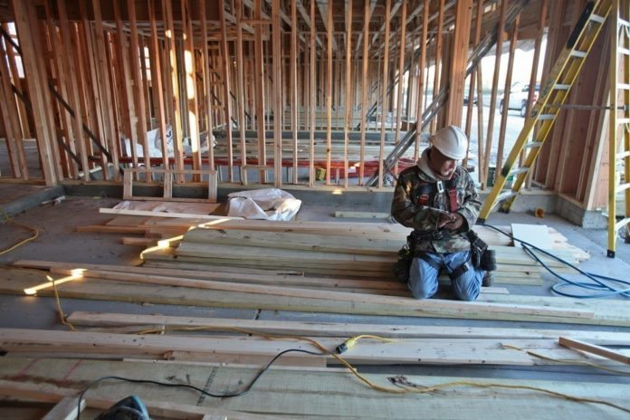 NEW-HOME CONSTRUCTION grew in the U.S. in July due to a rebound in multifamily building projects. / BLOOMBERG FILE PHOTO/TIM BOYLE