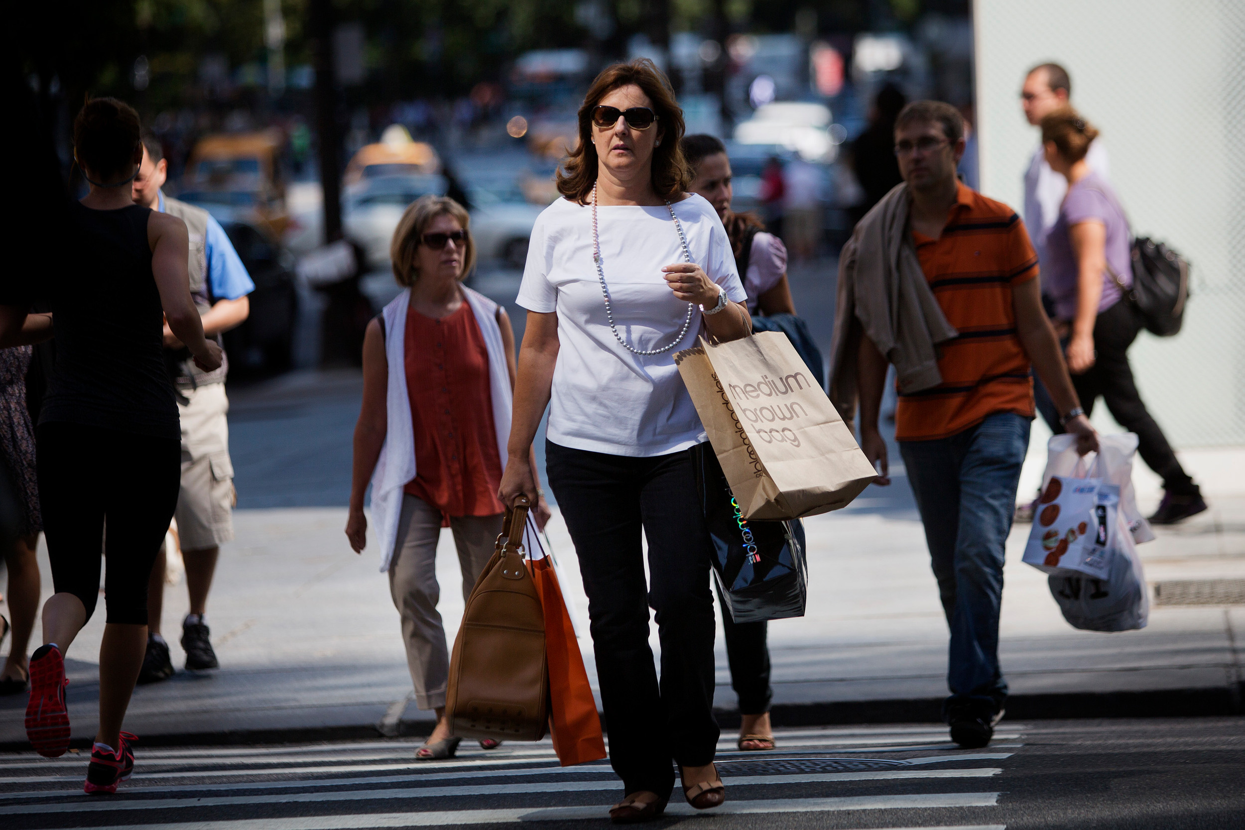 ecd48e34 A woman carries a shopping bag on Fifth Avenue in New York. The Department  of