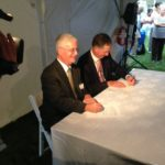 CARE NEW ENGLAND PRESIDENT AND CEO DENNIS KEEFE, left, and Interim President and CEO Arthur DeBlois III of Memorial Hospital sign the partnership agreement that officially binds Memorial to the CNE network at a ceremony held Tuesday on Memorial's Pawtucket campus. / PBN PHOTO/RICHARD ASINOF