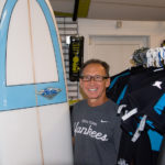 SURFS UP: Pete Pan, co-owner of Narragansett Surf and Skate, says business doubles when a hurricane is near. / PBN PHOTO/JOE MCGOVERN