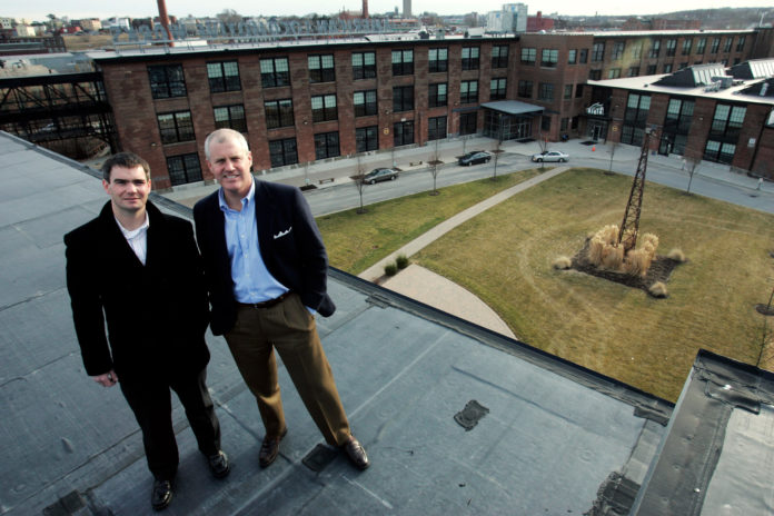 PEREGRINE PROPERTY MANAGEMENT principals Jeff Spratt, left, and Brendan Kane were photographed when they were named managers of the ALCO development in 2010. They will be retained by the new owners of the complex, Foundry Associates L.P. / PBN FILE PHOTO/MATTHEW HEALEY