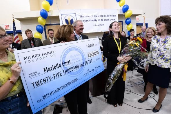 GOV. LINCOLN D. CHAFEE and previous Rhode Island Milken Educator Award winners present a check for $25,000 to Marielle Emet, a math teacher and academic dean at Blackstone Valley Prep Mayoral Academy and the 2013 winner of the award. Emet stands to the right, holding flowers, next to Blackstone Valley Prep Head of School Joy Souza and Jane Foley, senior vice president of the Milken Family Foundation. / COURTESY MILKEN FAMILY FOUNDATION