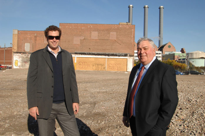 """ON THE HORIZON: Matt Fair, left, and Peter Hayes, brokers with Hayes & Sherry, at the site of the former Victory Plating Co. """"What the owners have asked us to do is expand the horizons for the site,"""" Fair said. / PBN PHOTO/BRIAN MCDONALD"""