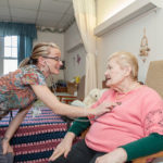 NURSE Roxanne Jardin, with a patient at Orchard View Manor Nursing and Rehabilitation Center. / PBN FILE PHOTO/TRACY JENKINS