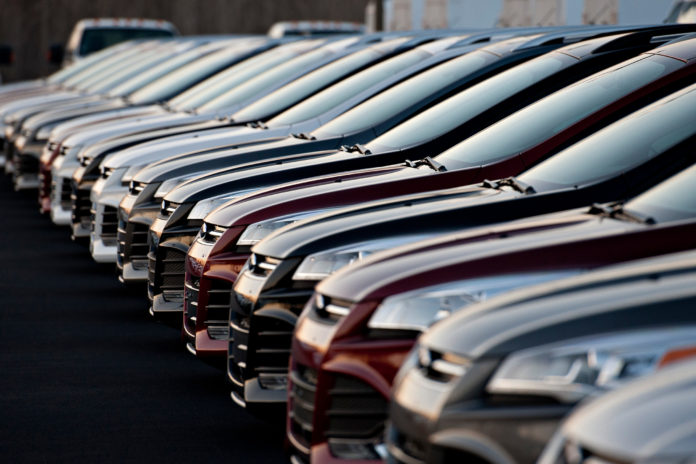 A ROW OF 2014 Ford Motor Co. Focus vehicles sit on display at Uftring Ford in East Peoria, Ill. Inventory buildup -- the largest since early 1998 -- partly accounted for an unexpected 3.6 percent growth in GDP for the third quarter. Economists surveyed by Bloomberg had predicted a 3.1 percent gain. / BLOOMBERG FILE PHOTO/DANIEL ACKER
