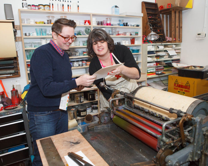 WORDS' WORTH: Arley-Rose Torsone and Morgan Calderini, co-owners of Ladyfingers Letterpress, founded the Pawtucket company in 2011. The company makes custom-designed invitations and greeting cards that personalize the message with old-fashioned hand lettering. / PBN PHOTO/TRACY JENKINS