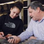 OPEN DIALOGUE: Peter Manickas, president of Metal Tile Technology, with employee Angalissa Reyes. Manickas sees value in sharing successes and failures with fellow businesses owners in the Entrepreneurial Exchange. / PBN FILE PHOTO/BRIAN MCDONALD