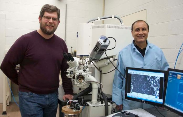 CLEAN SLATE: URI engineering assistant professor Geoff Bothun, left, and professor Arijit Bose are developing new technologies for cleaning oil spills. / COURTESY CHRIS BARRETT