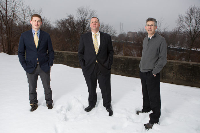 ECONOMIC ENGINE: From left, Pawtucket Foundation Executive Director Aaron Hertzberg, Pawtucket Mayor Donald R. Grebien and city Planning Director Barney Heath at a 7.4-acre Division Street lot targeted for redevelopment. / PBN PHOTO/RUPERT WHITELEY