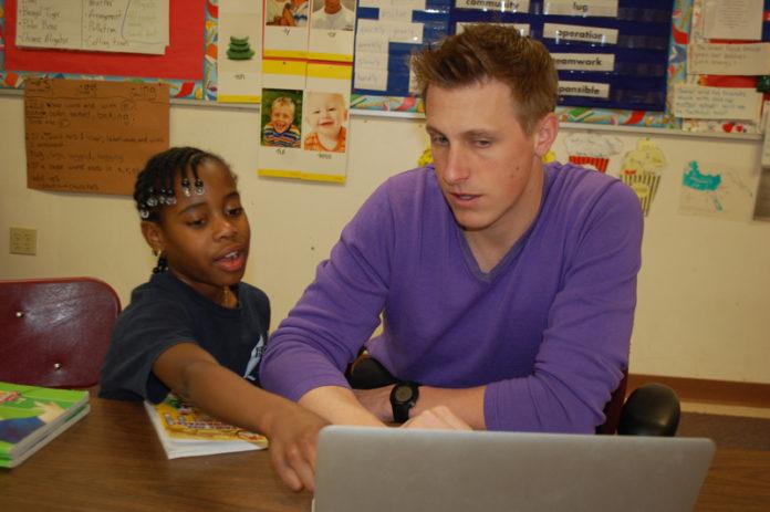 GO GETTER: Shandanea Hayden, a scholarship recipient from Warren, works with her second grade teacher, Mike Skazinski, at Barrington Christian Academy. / COURTESY ELSIE WRIGHT