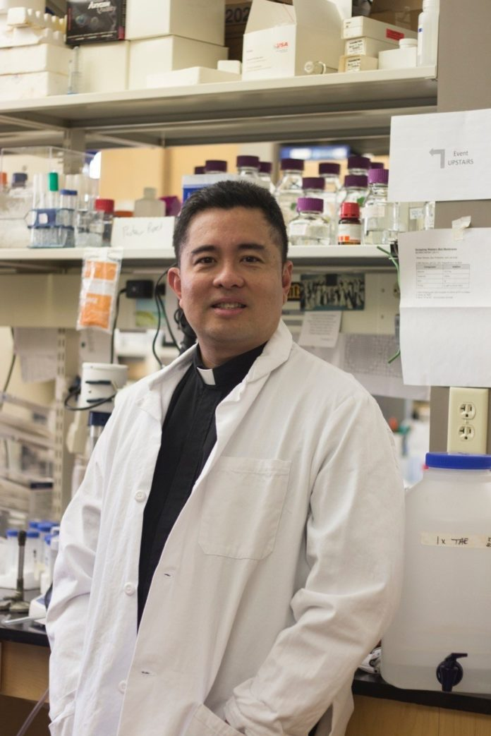 THE REV. DR. NICANOR AUSTRIACO has received a $257,049 grant from the National Institutes of Health/National Institute for General Medical Sciences to study the behavior of genes linked to human cancers such as lymphoma, leukemia, and prostrate and breast cancer. / COURTESY PROVIDENCE COLLEGE