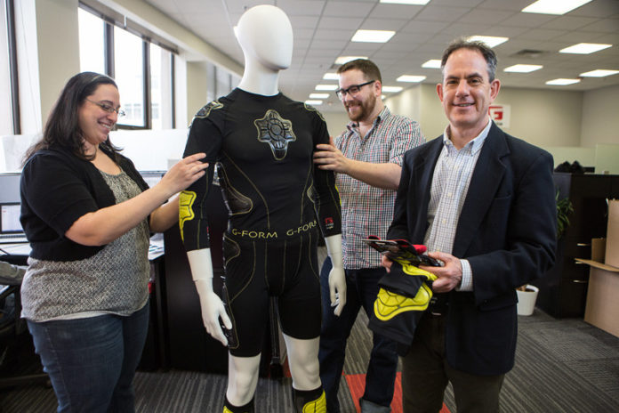 PROTECTING INNOVATION: G-Form Executive Chairman Danny Warshay, right, and his team, including Stephanie Thorn, director of product design, and Alex Seagrave, operations manager, are always looking for new uses of the company's groundbreaking, protective technology. / PBN PHOTO/RUPERT WHITELEY