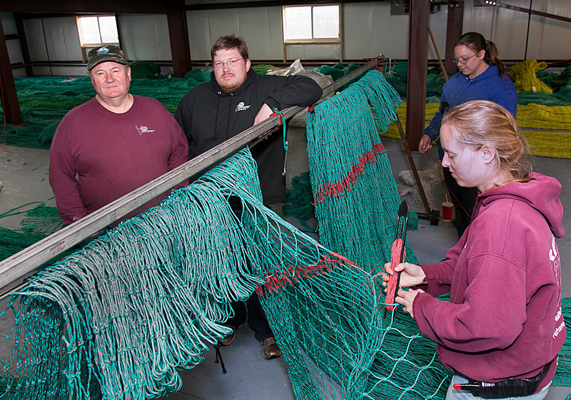 SUPPLY AND DEMAND: Reidar's Trawl Gear and Marine Supply expanded to a 21,000-square-foot New Bedford building last July. Above, owner Reidar Bendiksen, left, and son Tor Bendiksen, chief operating officer, with employees Meghan Lapp, front, and Sarah Fortin. / PBN FILE PHOTO/MICHAEL SALERNO