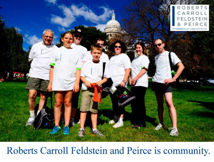 ALL IN THE FAMILY: Staff and family participated in the most recent CVS Caremark Downtown 5K run last fall in Providence. / COURTESY ROBERTS, CARROLL, FELDSTEIN & PIERCE