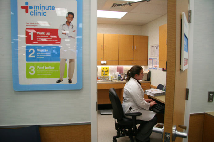 CVS CAREMARK CORP. and its MinuteClinic branch have affiliated with four health care providers in Connecticut, Texas, South Carolina and Louisiana to coordinate on clinical care and integrate electronic medical records. Above, nurse practitioner Corissa Pond enters patient data at a MinuteClinic in a Seekonk CVS/pharmacy. / PBN FILE PHOTO/MICHAEL PERSSON
