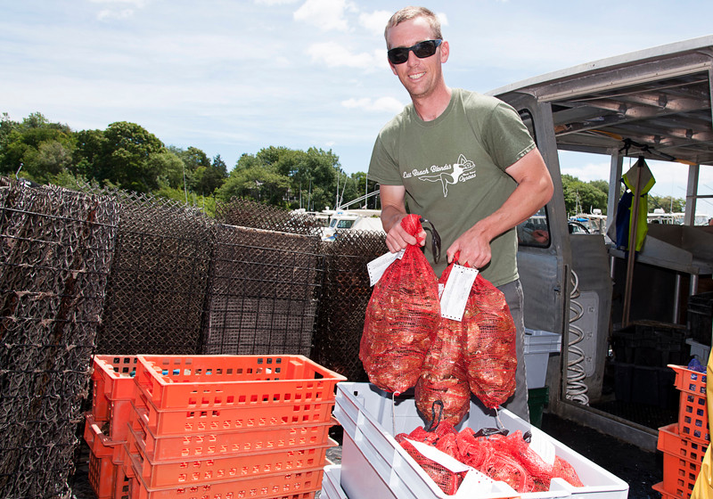 RAW NUMBERS: Jim Arnoux, owner of East Beach Farm, said his lease for the small area in Quonochontaug Pond is one way to grow and protect his oyster business. More than 6 million Rhode Island oysters were sold for consumption in 2013. / PBN PHOTO/MICHAEL SALERNO