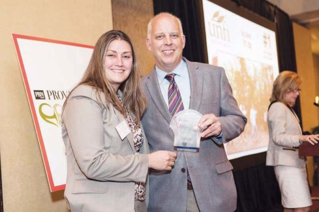 Nichole Wright accepts award for United Natural Foods - #1 among employers with 5000+ employees  