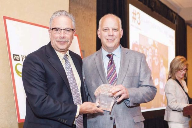 Care New England Senior VP Domenic Delmonico accepts CNE's award  / Rupert Whiteley