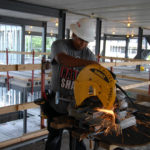 GILBANE CONSTRUCTION is seeing continued growth in both commercial and residential construction over the next 18 months, such as the work being done by Luiz Perez of Castro Drywall at the East Side's Premier Apartments building in the summer of 2013. / PBN FILE PHOTO/BRIAN MCDONALD