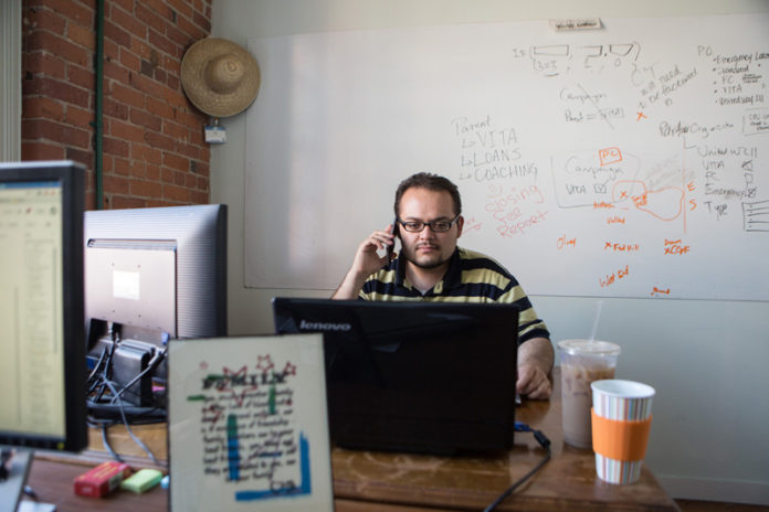 FUND RAISING: Frustrated with getting payday-loan controls passed in Rhode Island, some activists launched a nonprofit, Capital Good Fund. Pictured above is Capital Good Fund Loan Systems Manager Jose Fonseca. / PBN PHOTO/RUPERT WHITELEY