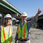 FINDING A FASTER WAY: When Patricia Steere founded her company, she found a niche in replacing bridges more quickly than it had been done traditionally. Here she confers with Chief Engineer Martin Pierce on the site of the Providence Viaduct replacement. / PBN PHOTO/RUPERT WHITELEY