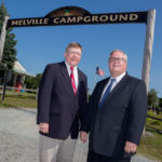 CAMPING OUT: Portsmouth Town Administrator John Klimm, left, and Finance Director Jim Lathrop at the Melville Ponds Campground. The town is looking for proposals for an operator to pay rent and share revenue. / PBN PHOTO/KATE WHITNEY LUCEY