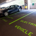 STAYING CURRENT: Several companies, including Fidelity Investments, are implementing electric-vehicle charging stations for their employees. Above, a car charges in the company's parking garage at 900 Salem St. in Smithfield. / PBN PHOTO/MICHAEL SALERNO