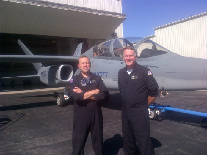 A GREATER VALUE: Textron test pilots Andy Vaughan, left, and Dan Hinson pose with the company's Scorpion fighter jet when it visited T.F. Green Airport recently. / COURTESY TEXTRON
