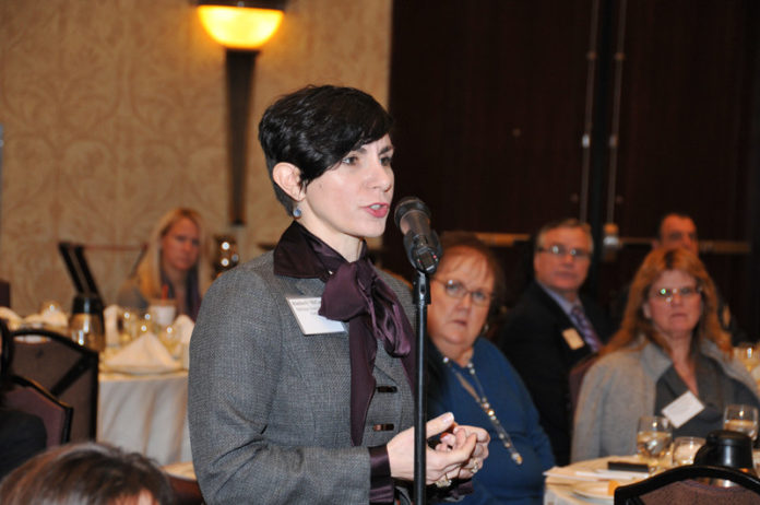 CROSS EXAMINATION: Kimberly McCarthy, a partner at Partridge Snow & Hahn, asks a question at the Providence Business News summit on Leadership and Entrepreneurship. / PBN PHOTO/MICHAEL SKORSKI